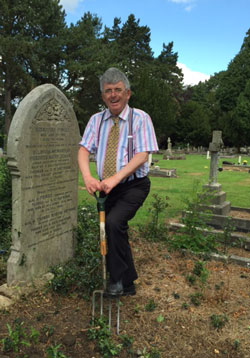 Volunteer, Simon Trehearne, helps to clear the Haywood family graves